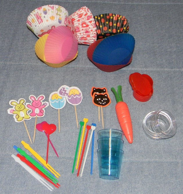 We have: some picks, some cups, a couple of sauce containers, silicone and paper side-dish cups.
